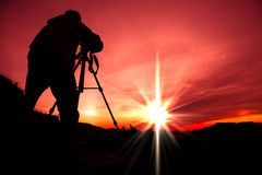 Silhouette of photographer. On the top of mountain Royalty Free Stock Photos