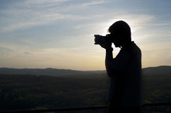 Silhouette of photographer Royalty Free Stock Photo