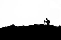Silhouette of photographer. Stock Photos
