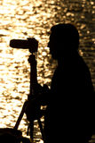 Silhouette of a photographer Royalty Free Stock Image