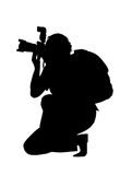 Silhouette of photographer. Black silhouette of photographer on white background Royalty Free Stock Photography