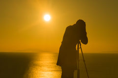 Silhouette of a photographer against a beautiful sunset  Stock Image