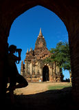 Silhouette of photographer in arch at the entrance to pagoda Royalty Free Stock Image