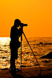 Silhouette Photographer on the beach Royalty Free Stock Image