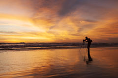 Silhouette of photographer on the beach Stock Image
