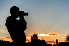 Silhouette of the photographer Royalty Free Stock Photo