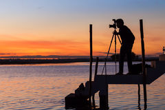 Silhouette of photographer. Stock Images