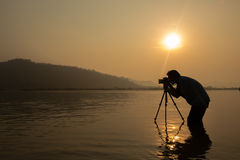 Silhouette photographer and camera. With sunset Stock Photo