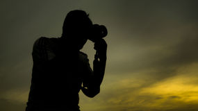 Silhouette of Photographer Stock Photo