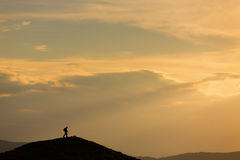 Silhouette of photographer on heal Stock Photos