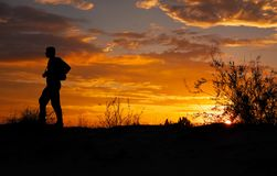 Silhouette of photographer with his camera at sunset royalty free stock photography