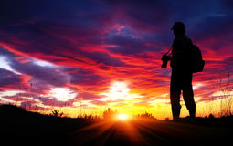 Silhouette of photographer with his camera Stock Photography