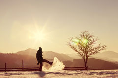 Silhouette of photographer playing with snow Royalty Free Stock Images