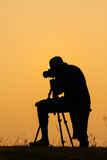 Silhouette of photographer shooting photo for a sunrise Royalty Free Stock Photography