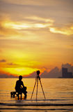 A silhouette of  photographer. Shooting for a sunrise Royalty Free Stock Images