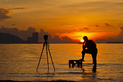 A silhouette of  photographer. Shooting for a sunrise Royalty Free Stock Photos