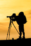 Silhouette of photographer shooting for a sunrise Royalty Free Stock Photo