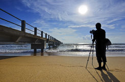 Silhouette of a photographer shooting the wooden bridge Stock Photo