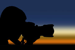 Silhouette photographer at sunrise Stock Photo