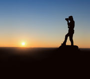Silhouette photographer at sunrise Stock Photography
