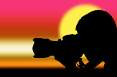 Silhouette photographer at sunrise Royalty Free Stock Image