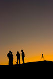 Silhouette of a photographer at sunset. A photographer with a tripod watches a desert sunset in silhouette royalty free stock photos