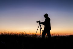 Silhouette of photographer. At sunset Royalty Free Stock Photo