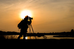 Silhouette photographer in sunset background Royalty Free Stock Photos