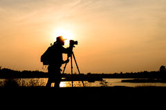 Silhouette photographer in sunset background Royalty Free Stock Image