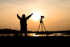 Silhouette photographer in sunset background Royalty Free Stock Photography