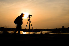 Silhouette photographer in sunset background Royalty Free Stock Images