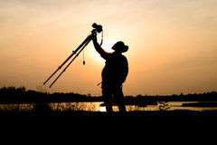 Silhouette photographer in sunset background Stock Photo