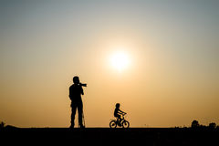 Silhouette photographer in sunset background Stock Photography
