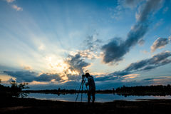 Silhouette photographer on sunset background Stock Photography