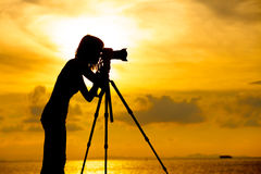 Silhouette photographer at sunset Royalty Free Stock Image