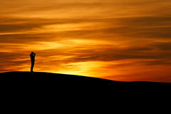Silhouette of photographer in sunset Royalty Free Stock Photo