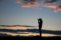 Silhouette of photographer in sunset Stock Photography
