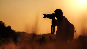 Silhouette of photographer Stock Image