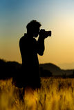 Silhouette of photographer Royalty Free Stock Images