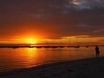 Silhouette of a photographer at sunset. St Kilda Beach, Melbourne, Australia stock photo