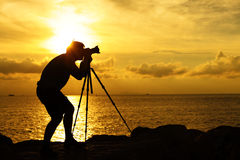 Silhouette photographer at sunset Stock Photo