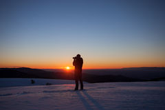 Silhouette of photographer in sunset Royalty Free Stock Image