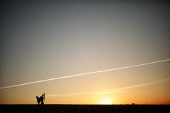 Silhouette of a photographer during the sunset. Silhouette of a young photographer during the sunset Stock Photography