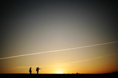 Silhouette of a photographer during the sunset. Royalty Free Stock Images