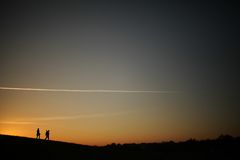 Silhouette of a photographer during the sunset. Stock Images