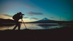 Silhouette Of Photographer Taking Photo At Mount Fuji stock photo