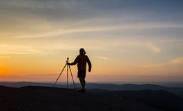 Silhouette of photographer taking photo in sunset Royalty Free Stock Photos
