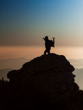 Silhouette of a photographer on the top of the mountain Stock Photos