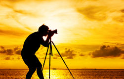 Silhouette of photographer with tripod Stock Photography