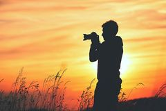 Silhouette of the photographer Royalty Free Stock Photography